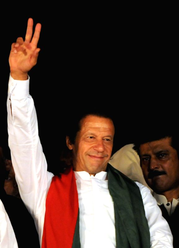 Pakistan Tehrik-e-Insaf leader Imran Khan gestures to his supporters during an anti-government protest in front of the parliament building in Islamabad, capital .. - Nawaz Sharif and Imran Khan