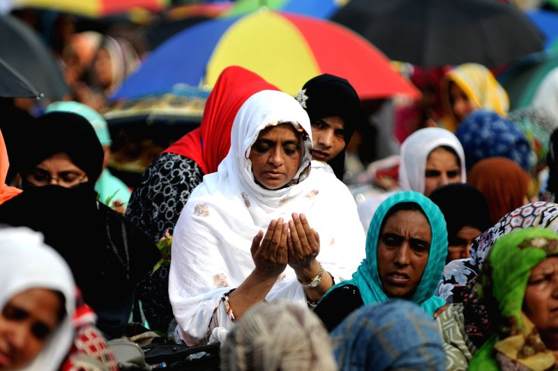 Pakistani supporters of religious leader Tahir-ul-Qadri participate in Friday prayers held at an anti-government protest site in front of Parliament in Islamabad . - Nawaz Sharif Friday