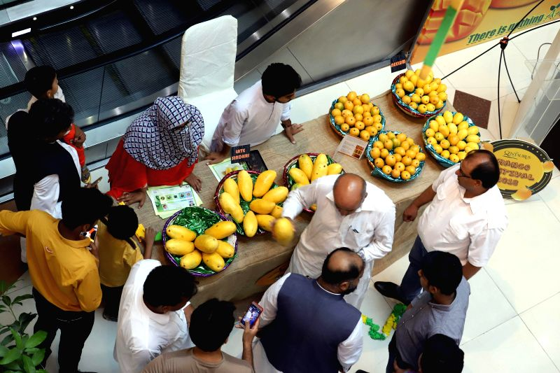 ISLAMABAD, Aug. 3, 2018 - People visit a mango stall during mango festival in Islamabad, capital of Pakistan on August 3, 2018. A three-day mango festival kicked off in Islamabad on Friday, ...