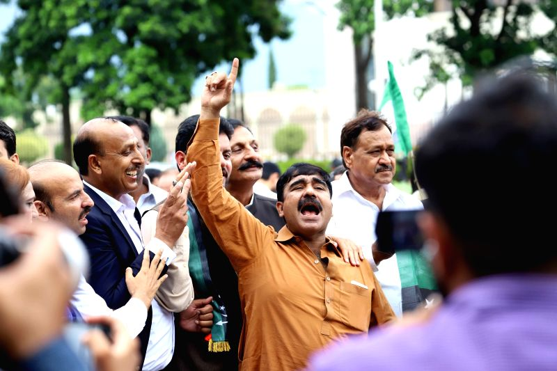 ISLAMABAD, Aug. 8, 2018 - A supporter of Pakistan Muslim League-Nawaz (PML-N) chants slogan outside the Election Commission of Pakistan office during a rally against rigging in Pakistan's general ...