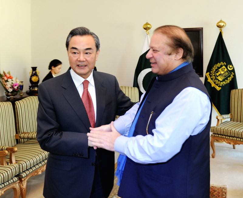 Pakistani Prime Minister Nawaz Sharif (R) shakes hands with visiting Chinese Foreign Minister Wang Yi in Islamabad, Pakistan, on Feb. 13, 2015. Pakistan and China - Nawaz Sharif