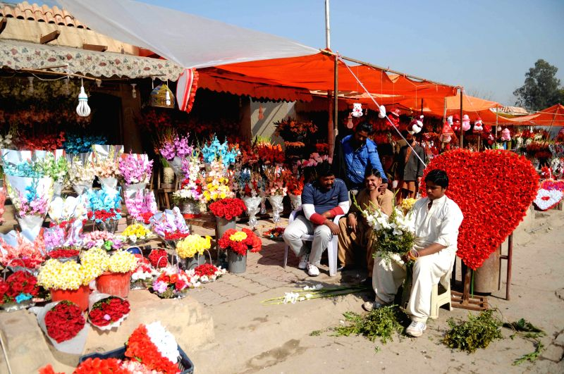 Vendors wait for customers in Islamabad, capital of Pakistan on Feb. 13, 2015, a day before Valentine's Day.