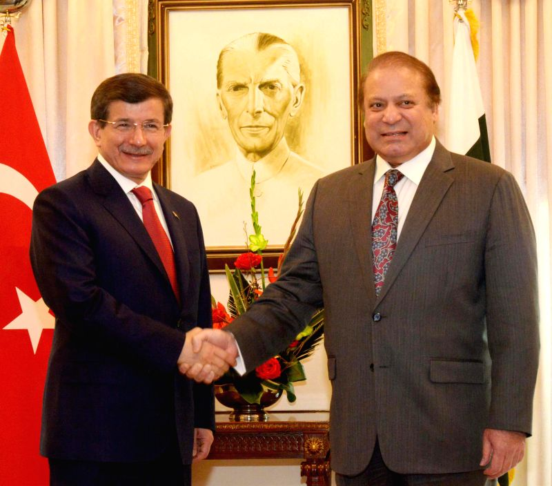 Photo released by Pakistan's Press Information Department (PID) on Feb. 17, 2015 shows Turkish Prime Minister Ahmet Davutoglu (L) shakes hands with Pakistani ... - Ahmet Davutoglu