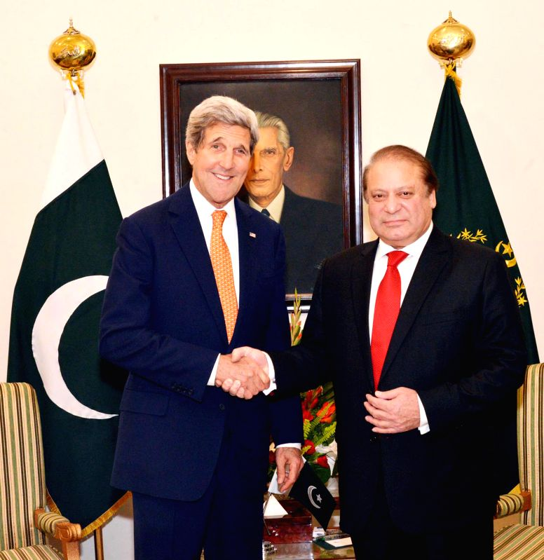 Photo released by Pakistan's Press Information Department (PID) on Jan. 12, 2015 shows Pakistani Prime Minister Nawaz Sharif (R) shaking hands with US Secretary ..
