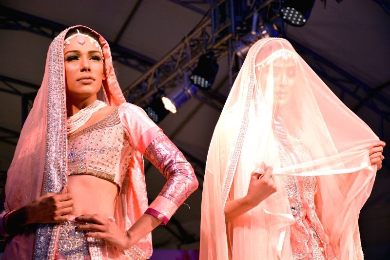 Models present creations by designer Sobia during a fashion show in Islamabad, capital of Pakistan on Jan. 26, 2015.