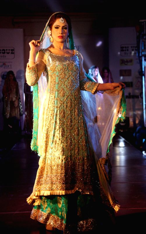A model presents a creation by designer Hameeda at a local hotel in Islamabad, capital of Pakistan, Jan. 3, 2015.