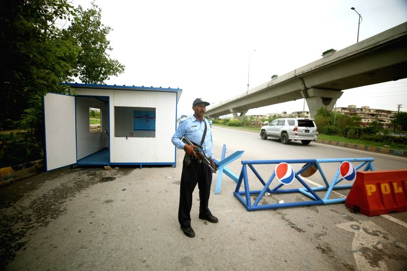 ISLAMABAD, July 23, 2018 - A policeman stands guard at a check-point due to security on high alert ahead of the county's general election in Islamabad, capital of Pakistan, July 23, 2018. Pakistan ...