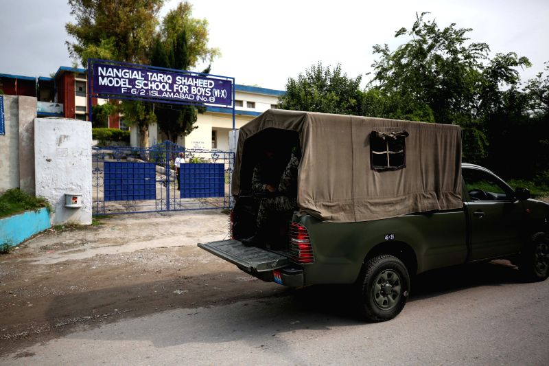 ISLAMABAD, July 25, 2018 - Soldiers patrol outside a polling station in Islamabad, capital of Pakistan, on July 25, 2018. Pakistanis started casting votes in the country's one-day general elections ...