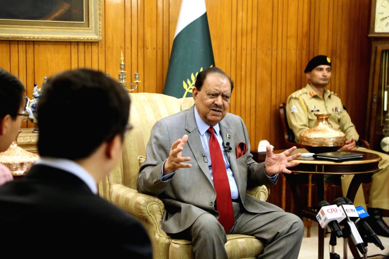 ISLAMABAD, June 7, 2018 - Pakistani President Mamnoon Hussain (C) speaks during an interview with Chinese media at the Presidential Palace in Islamabad, capital of Pakistan on June 6, 2018. Pakistani ...