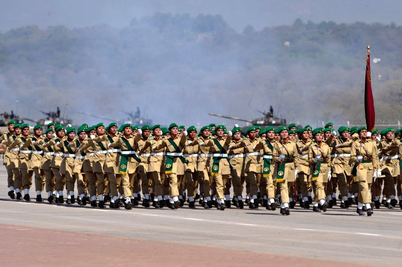 Pakistani female troops march during the Pakistan Day military parade in Islamabad, capital of Pakistan on March 23, 2015. Pakistan on Monday held a military ...