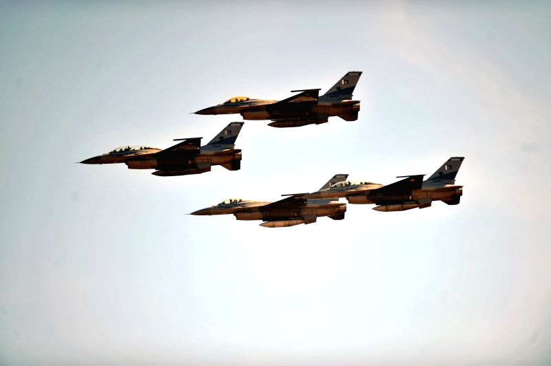 Pakistani jet fighters fly past during the Pakistan Day military parade in Islamabad, capital of Pakistan on March 23, 2015. Pakistan on Monday held a military ...