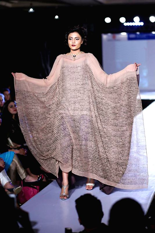 A model presents a creation by designer Nargis during a fashion show in Islamabad, capital of Pakistan on March 29, 2015.