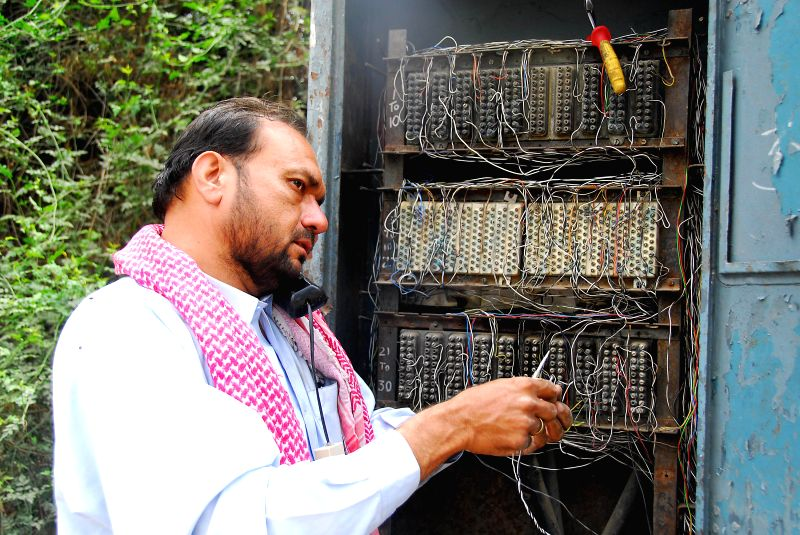 An engineer repairs telecom board on World Telecommunication and Information Society Day in Islamabad, capital of Pakistan on May 17, 2014. World Telecommunication