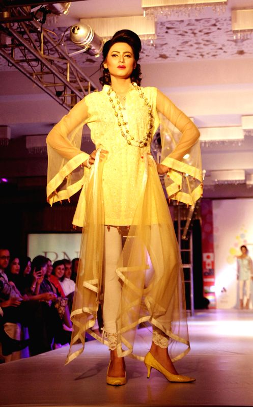 A model presents a creation by designer Nabila during a fashion show in Islamabad, capital of Pakistan on May 3, 2015.