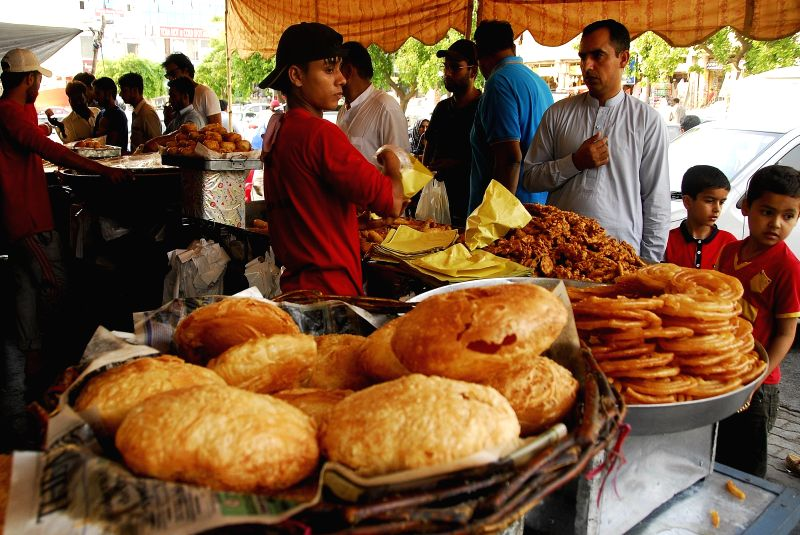 ISLAMABAD, May 30, 2017 - People buy food for Iftar during holy month of Ramadan in Islamabad, Pakistan, on May 30, 2017. Iftar refers to the evening meal when Muslims break their fast during the ...