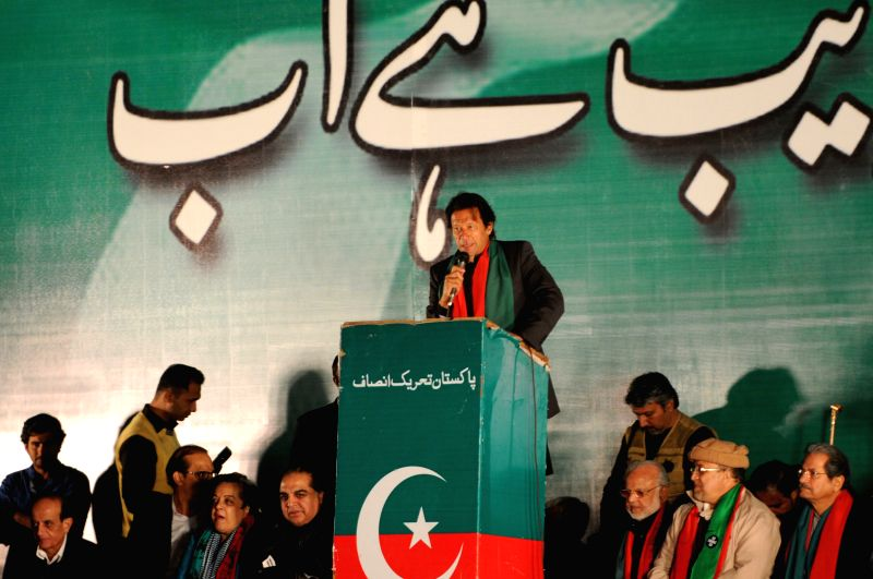 Islamabad (Pakistan): Imran Khan, leader of Pakistan Tehrik-e-Insaf (PTI) or Justice Movement Party, addresses his supporters during an anti-government rally  in front of the Parliament in Islamabad, - Imran Khan