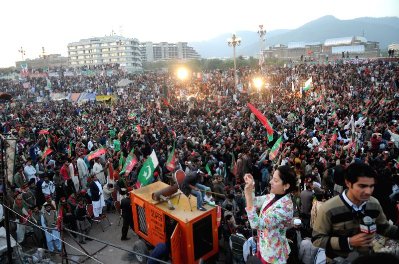 Islamabad (Pakistan): Supporters of Pakistan Tehreek-e-Insaf (PTI) attend an anti-government rally in front of the Parliament in Islamabad, capital of Pakistan on Nov. 30, 2014. Pakistan's ... - Imran Khan