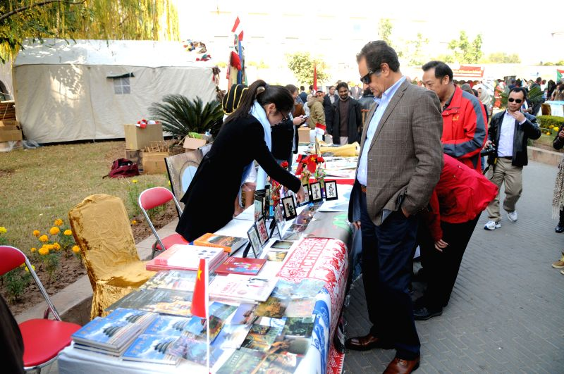 Pakistani people visit Chinese stall during Pakistan Foreign Office Women's Association (PFOWA) Annual Charity Bazaar at Serena Hotel in Islamabad, capital of Pakistan, Dec. 7, 2014. The ..