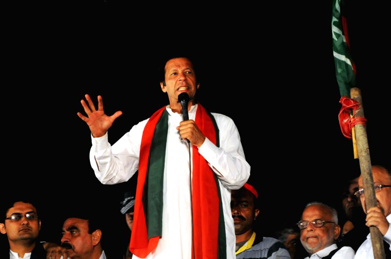 Leader of Pakistan Tehrik-e-Insaf party Imran Khan addresses supporters during an anti-government protest near the prime minister's residence in Islamabad, ... - Nawaz Sharif and Imran Khan