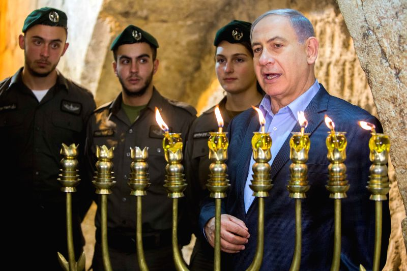 Israeli Prime Minister Benjamin Netanyahu (1st R) attends a ceremony to mark the fifth night of Hanukkah at the Western Wall in the Old City of Jerusalem, on Dec. 20, 2014. Hanukkah, also known as ... - Benjamin Netanyahu