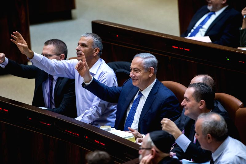 Israeli Prime Minister Benjamin Netanyahu (3rd L, Front) and Israeli Finance Minister Moshe Kahlon (2nd L, Front) gesture during the state budget vote for ... - Benjamin Netanyahu