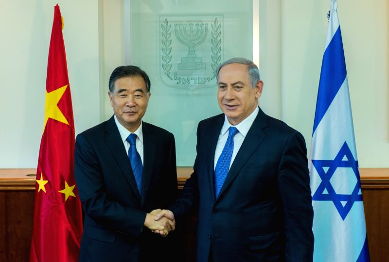 Israeli Prime Minister Benjamin Netanyahu (R) shakes hands with visiting Chinese Vice Premier Wang Yang during their meeting at the Prime Minister's Office in ... - Benjamin Netanyahu