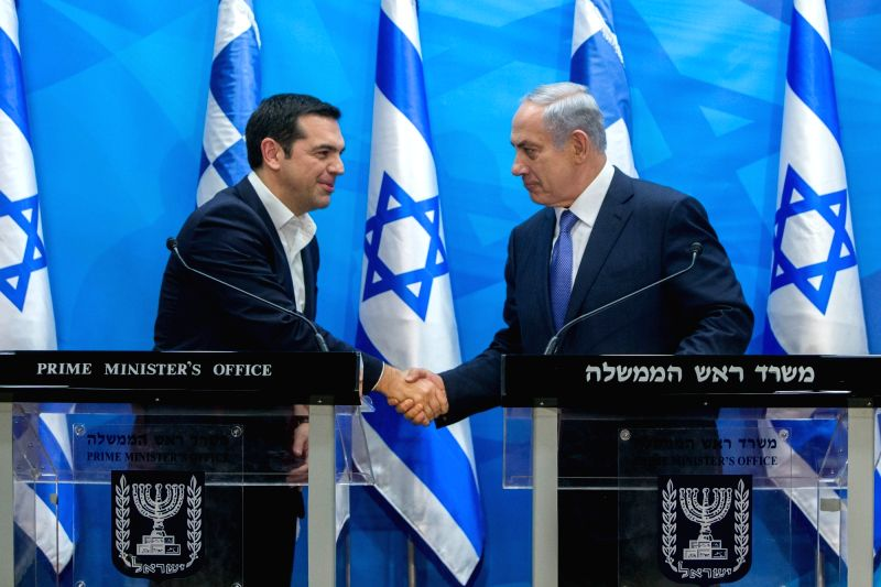 Israeli Prime Minister Benjamin Netanyahu(R) shakes hands with his Greek counterpart Alexis Tsipras during a joint press conference in Jerusalem, on Nov. 25, ... - Benjamin Netanyahu