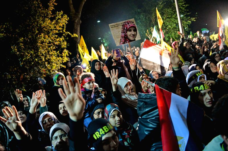 Supporters of ousted Egyptian President Mohamed Morsi chant slogans and carry banners against the Egyptian military during a protest in Istanbul, Turkey, on April