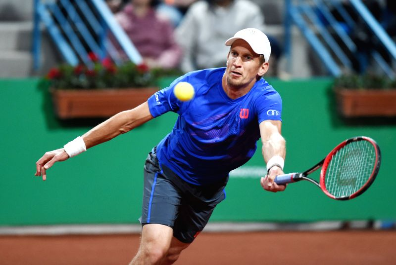 Jarkko Nieminen of Finland returns the ball during his second round match against Roger Federer of Switzerland at ATP World Tour Istanbul Open in Istanbul, ...