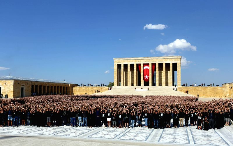 Six thousand volunteers gather in the mausoleum of Mustafa Kemal Ataturk, the founder of the Republic of Turkey, to form giant portrait of him to mark the Victory .