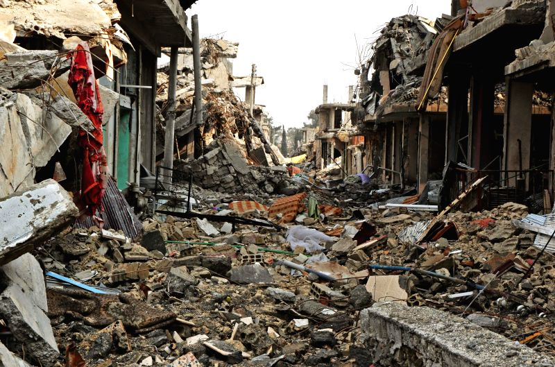 Photo taken on Jan. 31, 2015 shows the Syrian town of Ayn al-Arab full of damaged buildings following a five-month clashes between the Kurdish fighters and the ...