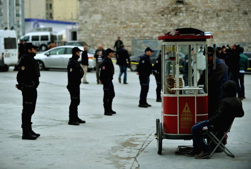 Police cordone off the area in Taksim Square in Istanbul on Jan. 30, 2015. An unidentified woman opened fire on police officers with a kalashnikov AK-47 in ...