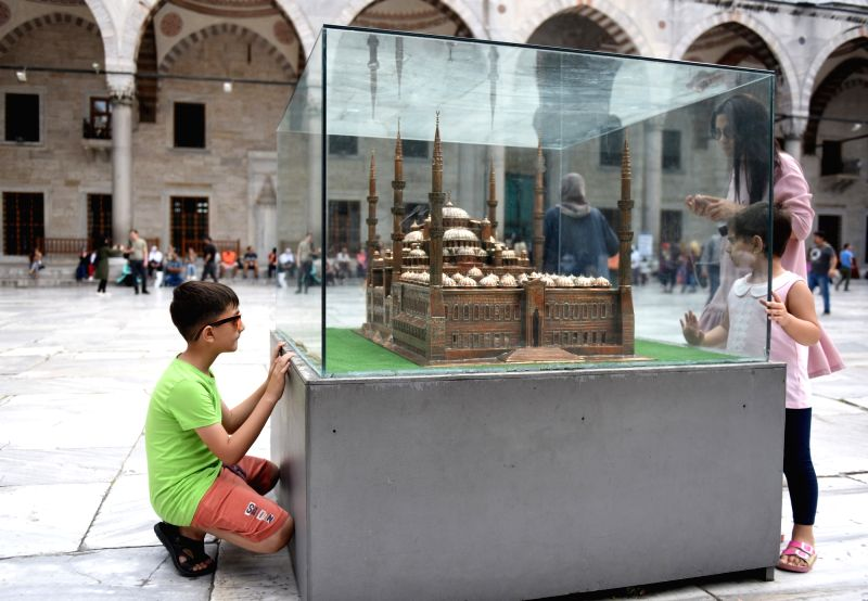 ISTANBUL, Jan. 31, 2018 - Tourists watch a model of Blue Mosque in Istanbul, Turkey, on Sept. 21, 2017. Turkey's tourism revenue grew 18.9 percent to 26.3 billion U.S. dollars in 2017, show official ...