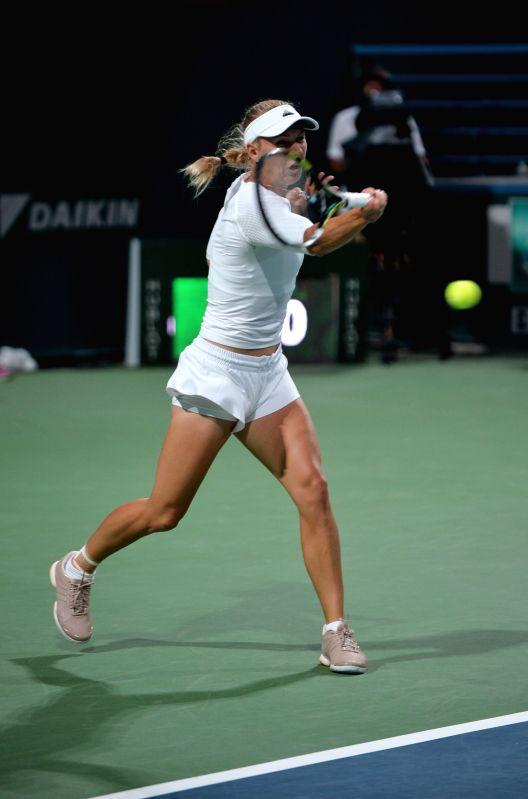 Caroline Wozniacki of Denmark hits a return to Karin Knapp of Italy during their WTA Istanbul Cup match in Istanbul, July 16, 2014. Wozniacki won the match 2-1.