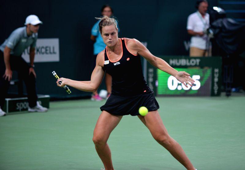 Karin Knapp of Italy hits a return to Caroline Wozniacki of Denmark during their WTA Istanbul Cup match in Istanbul, July 16, 2014. Wozniacki won the match 2-1.