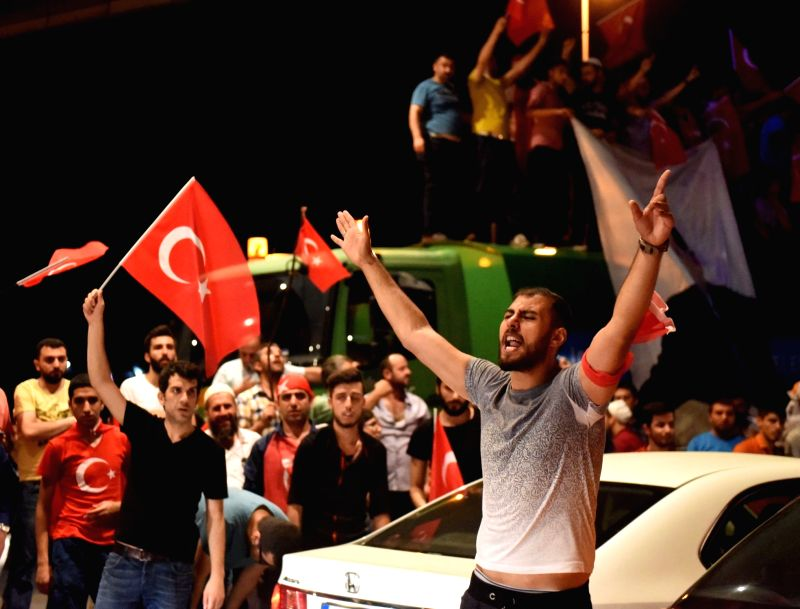 ISTANBUL, July 18, 2016 - People participate in a rally in support of Turkish President Recep Tayyip Erdogan at the Ataturk airport in Istanbul, Turkey, July 18, 2016. Turkey's Foreign Ministry said ...