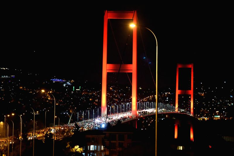 ISTANBUL, July 22, 2016 - People attend a rally at the Bosphorus Bridge in Istanbul, Turkey, on July 21, 2016. Thousands of Turks gathered on Thursday night on the bridge in Istanbul to denounce a ...