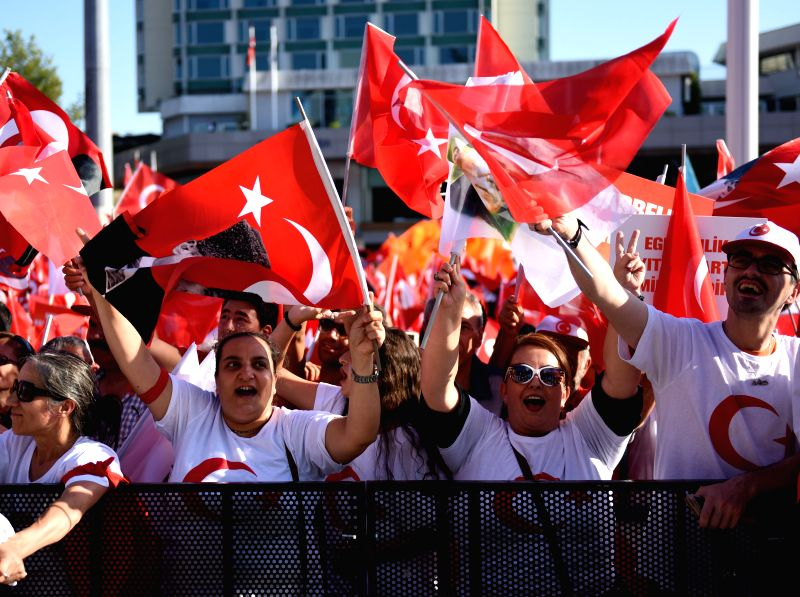 ISTANBUL, July 25, 2016 - People attend a rally at Istanbul's Taksim square in Turkey, on July 24, 2016. Tens of thousands of Turks on Sunday flocked to a rally in Istanbul organized by the main ...