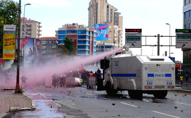 Police fired tear gas and water cannon to disperse protestors in Istanbul, Turkey, on May 1, 2014. Riot police fired tear gas, rubber bullets and water cannons ...