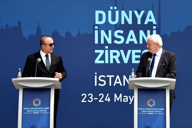 ISTANBUL, May 21, 2016 - United Nations Under-Secretary-General for Humanitarian Affairs and Emergency Relief Stephen O'Brien(R) and Turkish Foreign Minister Mevlut Cavusoglu talk during a flag ... - Mevlut Cavusoglu