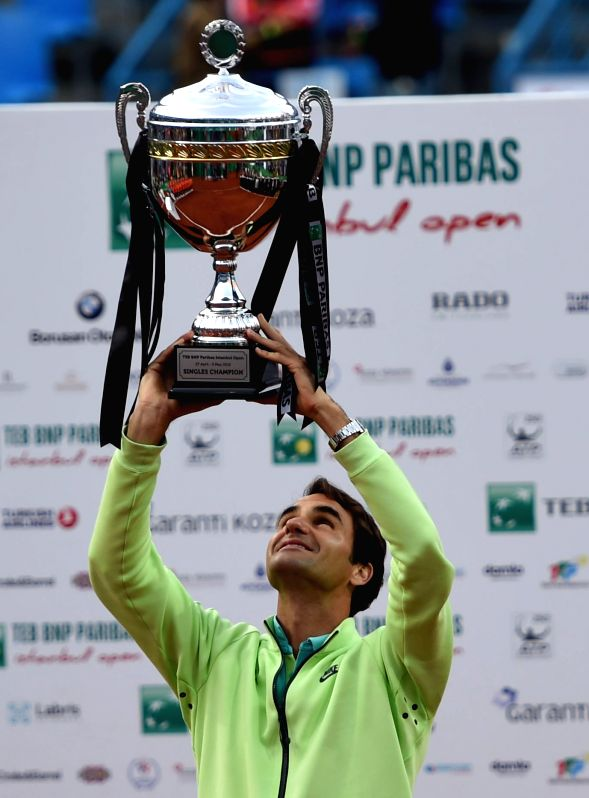 Roger Federer of Switzerland lifts the trophy after the Men's Singles final against Pablo Cuevas of Uruguay at 2015 ATP World Tour Istanbul Open in Istanbul, Turkey, ...