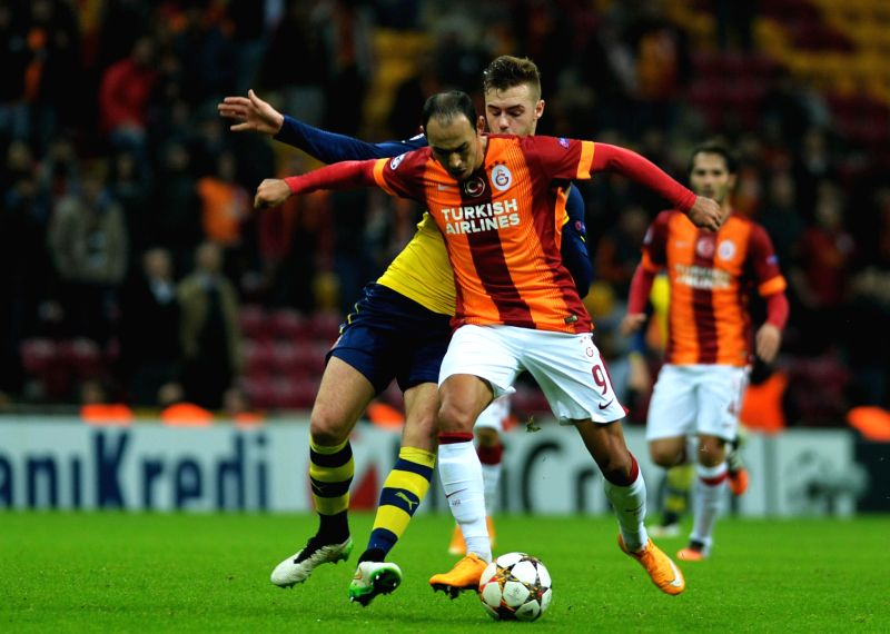 Istanbul (Turkey):  Galatasaray's Umut Bulut vies for the ball during the UEFA Champions League group D football match against Arsenal at Ali Sami Yen Stadium in Istanbul, Turkey, on Dec. 9, 2014. ...