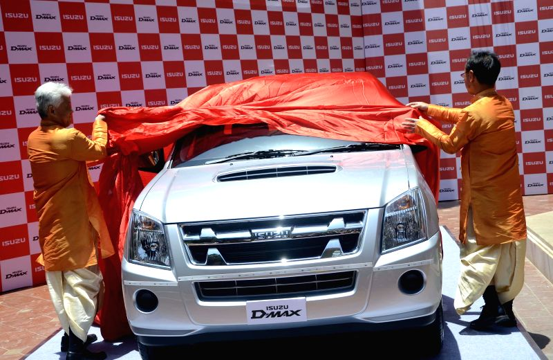 ISUZU, MD, Takashi Kikuchi and  ISUZU motors India Pvt Ltd, Deputy Managing Director Shigeru Wakabayashi  launch its pick-up trucks in in Mumbai on May 13, 2014.
