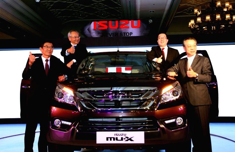 Isuzu Motors Director Hiroshi Nakagawa, Isuzu Motors India Chairman Naohiiro Yamaguchi, IEBCI Director Hiroyasu Miura at the launch of mu-X Isuzu SUV, in New Delhi on May 11, 2017.