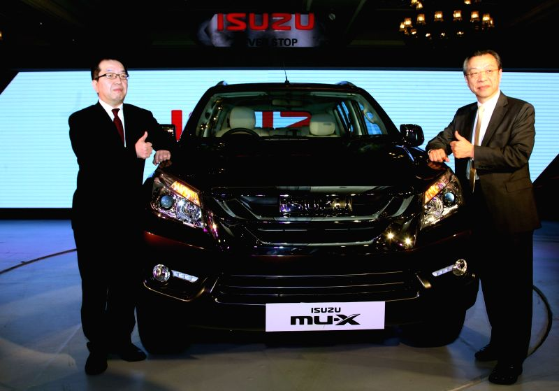 Isuzu Motors Director Hiroshi Nakagawa (R) and Isuzu Motors India Chairman Naohiiro Yamaguchi, at the launch of Mu-X Isuzu SUV, in New Delhi on May 11, 2017.