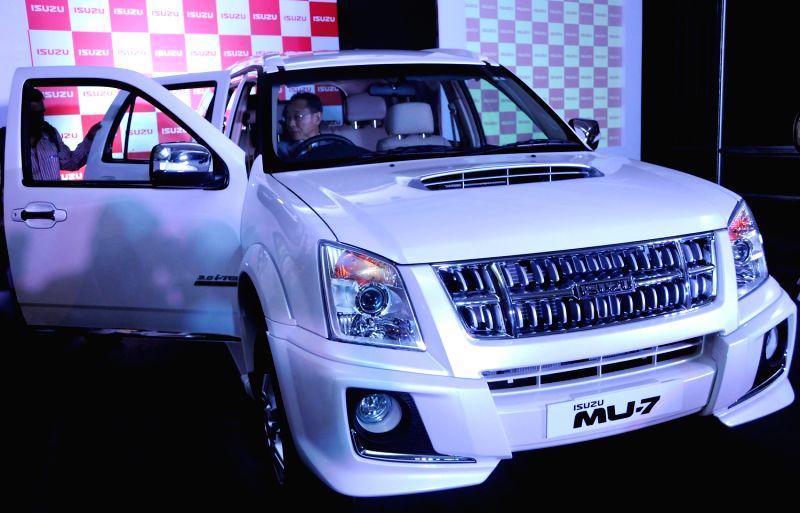 Isuzu Motors India Pvt. Ltd President and MD Takashi Kikuchi and ...