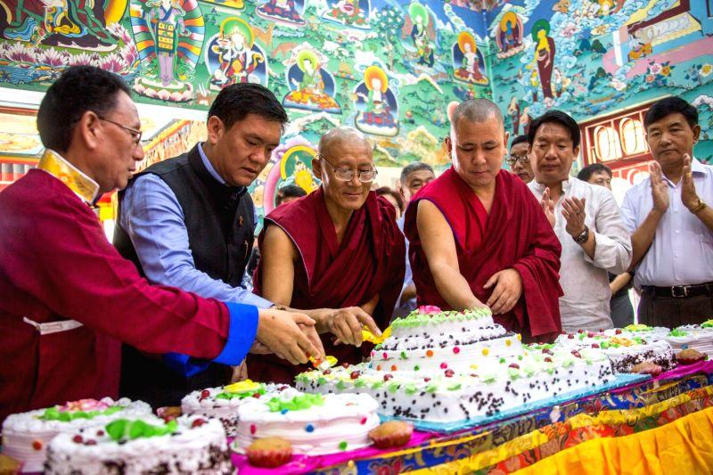 Itanagar: Arunachal Pradesh Chief Minister Pema Khandu cuts a cake during the 84th birthday celebrations of spiritual leader the Dalai Lama, at the Centre for Buddhist Culture Gompa in Itanagar on July 6, 2019.