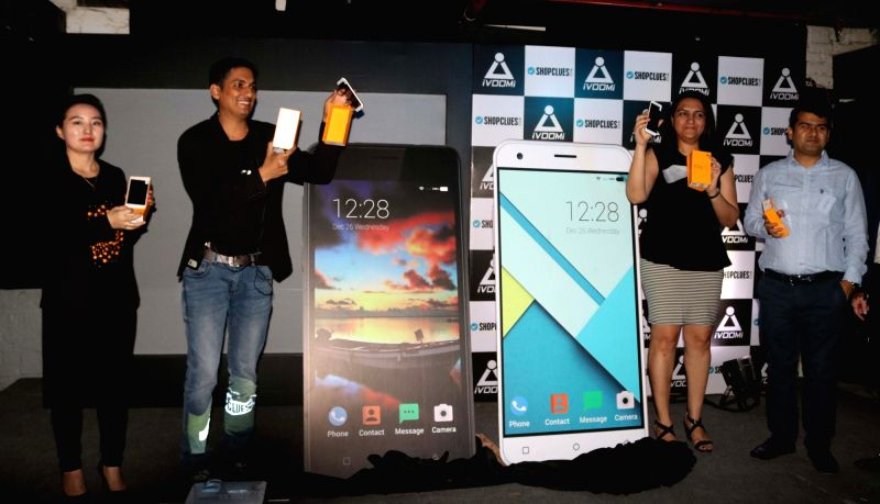 Ivoomi CEO Ashwin Bhandari with Director Product Marketing Jessy and Shopclues.com co-founder Radhika Agarwal at the launch of new smartphones in New Delhi, on April 25, 2017.