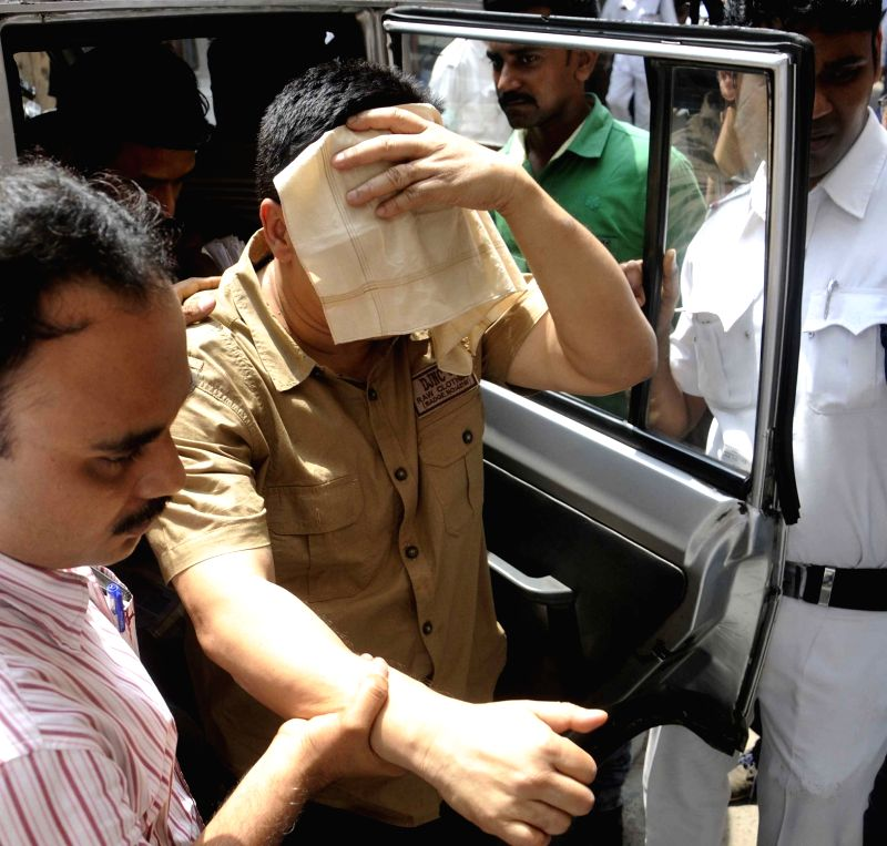 IVRCL assistant vice president (Kolkata) Ranjit Bhattacharya, one of the accused in Vivekananda flyover collapse case being taken to be produced in a Kolkata court on April 5, 2016.