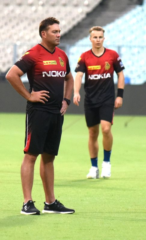 Jacques Kallis and Tom Curran of Kolkata Knight Riders during a practice session, in Kolkata on April 12, 2018.
